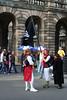 Performers advertising their festival fringe show on Edinburgh's Royal Mile