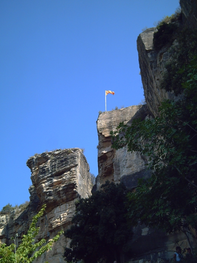 Sant Miquel Del Fai Cliffs and Catalan Flag