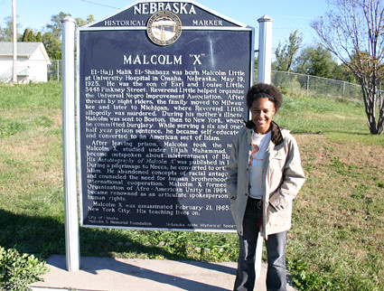 Adrienne at Malcolm X marker