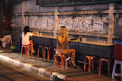A Thai prostitute beautifying herself at Nana Plaza, Bangkok, Thailand photo by www.igorbilicphotography.com