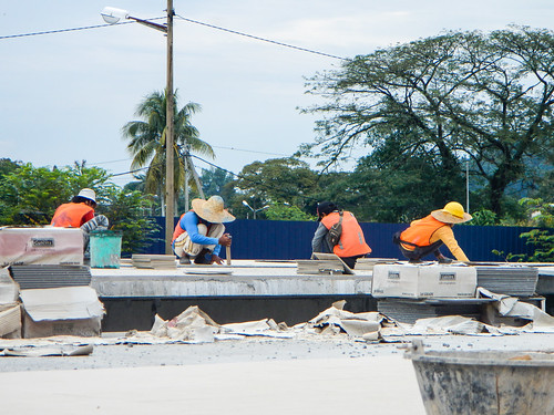 Workers building train station