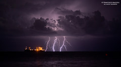 Tankship during a lightning storm photo by Francesco Magoga Photography