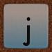 cardboard tile letter j
