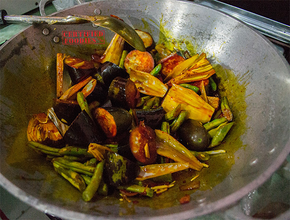 Cooking vegetables for beef kare-kare with annatto or atsuete oil