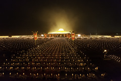 Thousands of monks light candles during Lunar Makha Bucha festival photo by www.igorbilicphotography.com