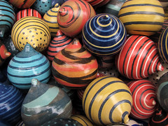 Multicolored Spinning Tops photo by Batikart