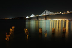 Pilings + Bay Bridge at Night [Explored] photo by doctah