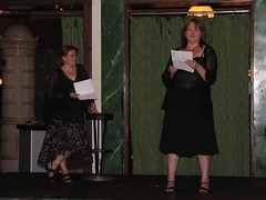 Anne Leinonen and Katja Salminen standing on stage reading