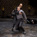 Horatio (Kareem Bandealy) and Hamlet (Scott Parkinson). Laertes (Timothy Edward Kane) and Claudius (Michael Canavan) in background in HAMLET at Writers' Theatre. Photo by Michael Brosilow.