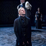 Hamlet (Scott Parkinson).  Claudius (Michael Canavan) and Ophelia (Liesel Matthews) in background in HAMLET at Writers' Theatre. Photo by Michael Brosilow.