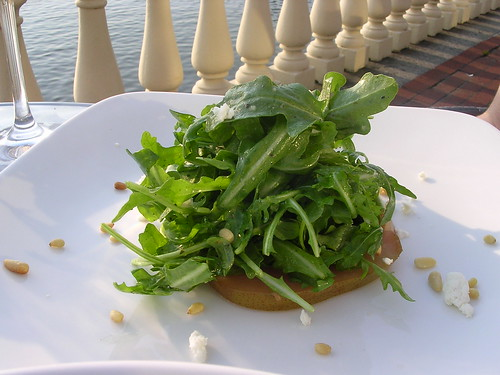 Arugula Salad with Wine-Poached Pears, Pine Nuts, Goat Cheese and Champagne Vinaigrette