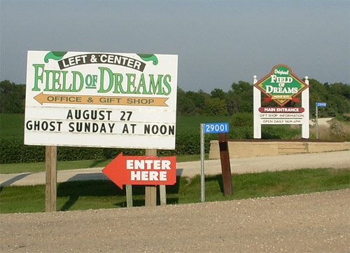 competing signs to entrance of field of dreams