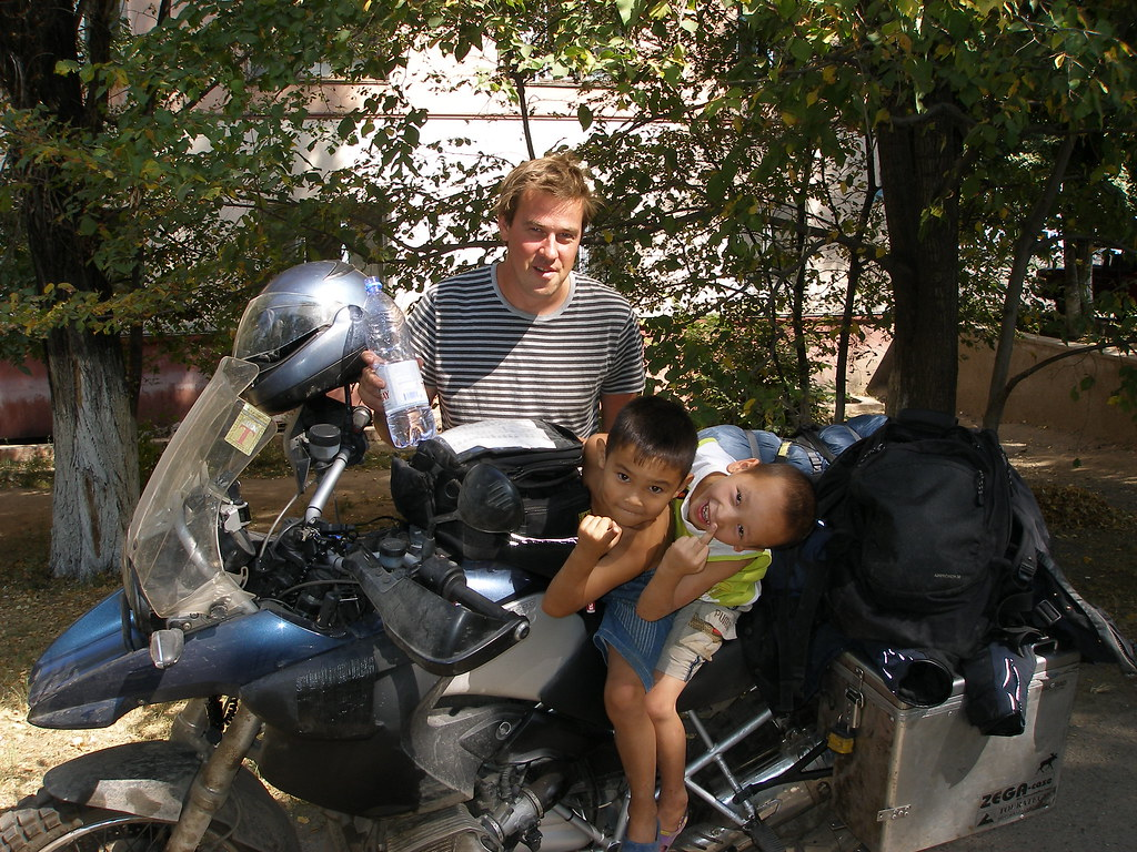 Kids on the bike - ouside the hostel - Almaty