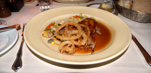 Grilled Wolfe Ranch quail with succotash,white corn polenta, and onion rings