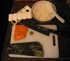[workspace with salmon, nori, rice, mold, knife, wasabi]