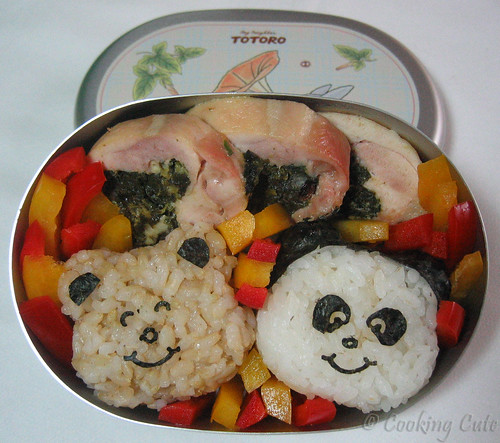 [one-tier bento with stuffed chicken thighs and panda and bear onigiri]