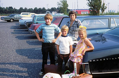 A somewhat nerdy 14 year old me on top of dad's 1965 Pontiac with our L.A. cousins who just arrived to spend the whole summer with us in Milford, Connecticut. JFK airport. Queens New York. July 1973. photo by wavz13