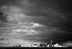 31: dark clouds with white barns photo by Jen MacNeill