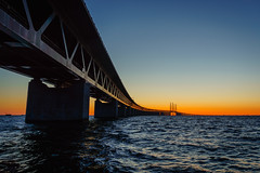 Along the Øresund Bridge at sunset photo by Fredde Nilsson