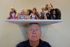 Portrait of a Man Who Likes to Balance Barbies on His Head photo by ricko
