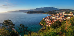 sunrise over the village of Lastres photo by Gene Krasko Photography