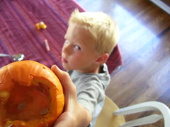 Aiden's salute to wee hallowed out pumpkins.