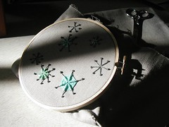 Crewel stars in the embroidery hoop