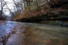 Day 19...rainy, overcast skies, flowing rivers, rich autumn colors and long exposure photo by drjoshferrell