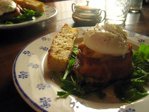 Poached Eggs on Pan Fried Polenta Cakes Wrapped in Pancetta