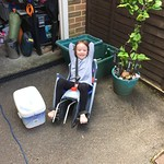 Amy thinks she still fits in the bike seat<br/>17 May 2015