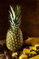 Organic Raw Yellow Pineapple photo by brent.hofacker