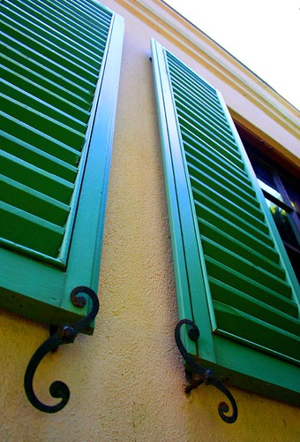 Green Shutters on Yellow