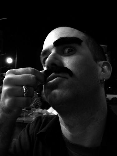 a moustachioed man