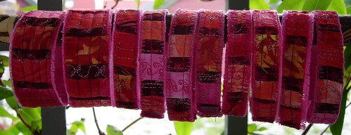 Pink bracelets on a stick