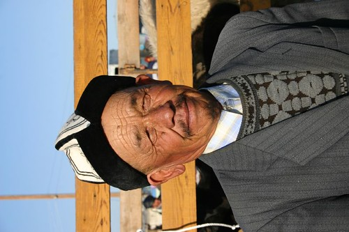 Hat man at the animal market in Karakol...