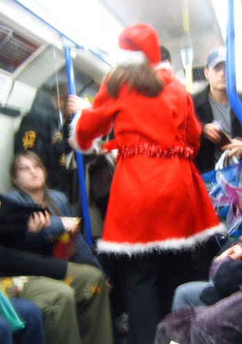 Santa collecting money on the London Underground