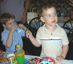 Bradley and Jake eating birthday cake.