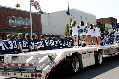 Life on a flatbed truck with cheerleaders