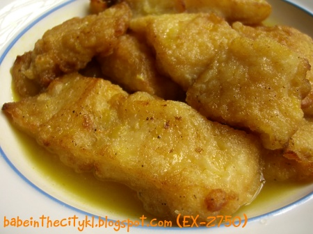 dory slices in orange sauce
