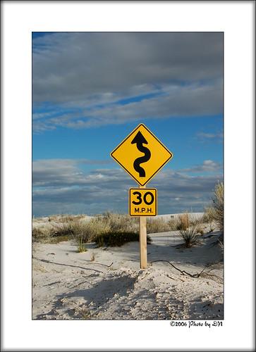 curving road sign