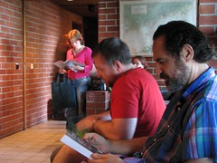 Justina Robon, Jeff VanderMeer and Stepan Chapman checking out the contents of their goodie bags