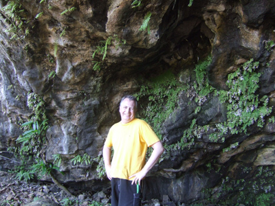 Lynsey at the entrance to the dry cave at Haena, North Kauai
