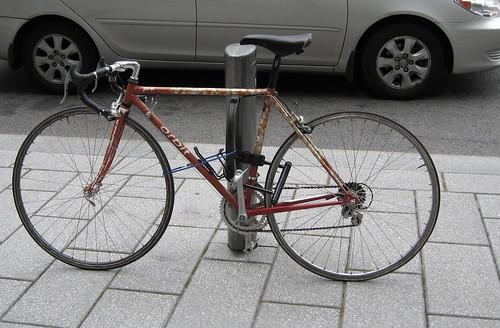Bike locked to parking sign