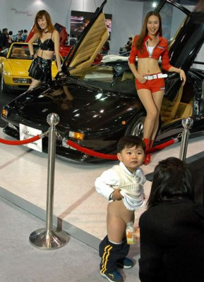 A Korean Boy Peeing In A Bottle In Front Of A Lamborghini