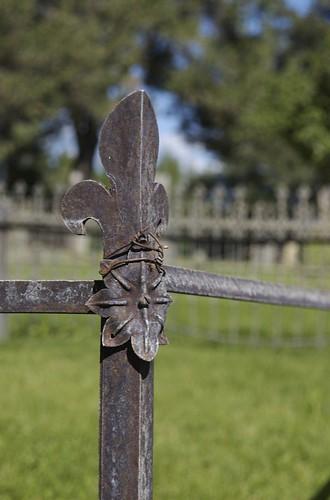 Corner Of A Gravesite Fence