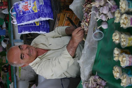 The Garlic Man. Margilan Sunday Bazar. Uzbekistan.