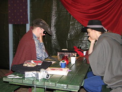 Two persons playing a board game at the inn