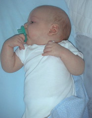 Matthew holding on to his pacifier - 8 weeks.
