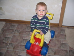 Benjamin riding his car