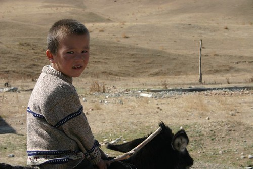 Kyrgyz boy on donkey. East of Osh. September 2006.